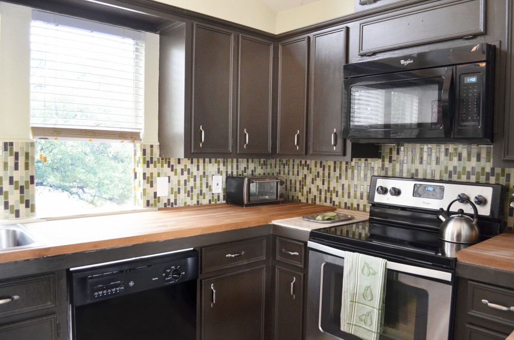 Austin vacation rental with Plenty of room in the kitchen and fully stocked for cooking or baking with windows overlooking the beautiful Oak trees  Provided is Bakeware  Measuring Cups  Kitchenaid Mixer  Pots and Pans  Crockpot and more  There is also a Dishwasher  Stove  Microwave