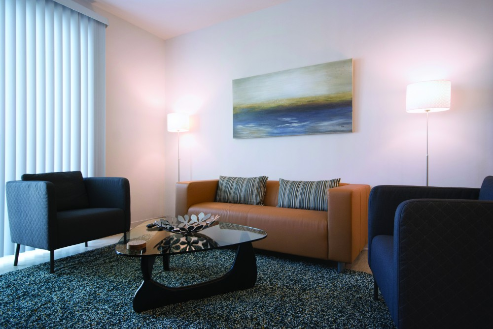Atlanta vacation rental with Furnished Living Room with Modern Interior Design - Corporate Apartments - 1-Bedroom Spectacular Suites