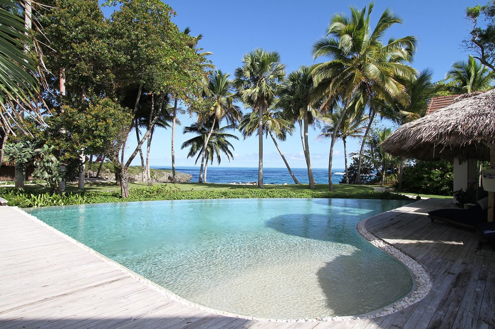 Sosua vacation rental with Infinity pool with lap lane and view to yard & private beach