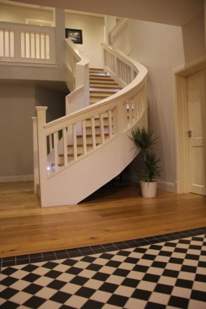 Killarney vacation rental with Grand entrance hall with curved stairs and gallery