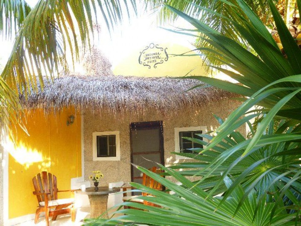 El Cuyo vacation rental with The Lodge with screened in porch, table , chairs and 2 benches