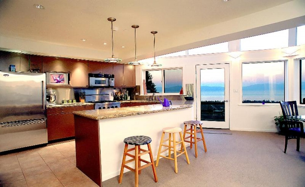 Lake Tahoe North Shore vacation rental with Dining Room with kitchen in background